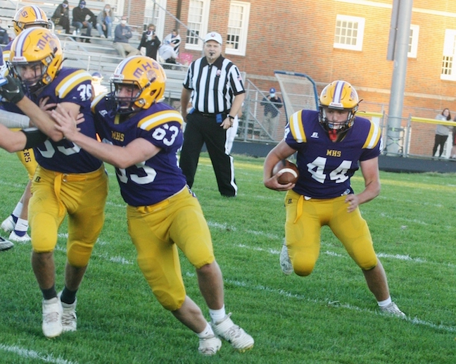 McClain's Andrew Potts (No. 44) runs the football during Friday's game vs. Chillicothe.