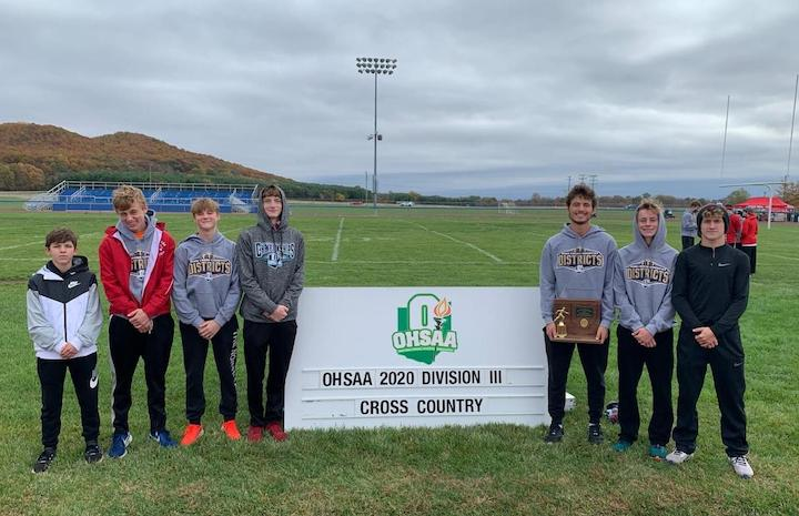 Members of the Fairfield Lions cross-country team are pictured after winning a 10th consecutive district championship Saturday at Southeastern High School. (Submitted photos)