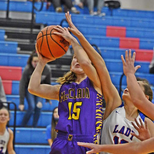 Iva Easter shoots a basket Saturday in the Lady Tigers' win over Greeneview.